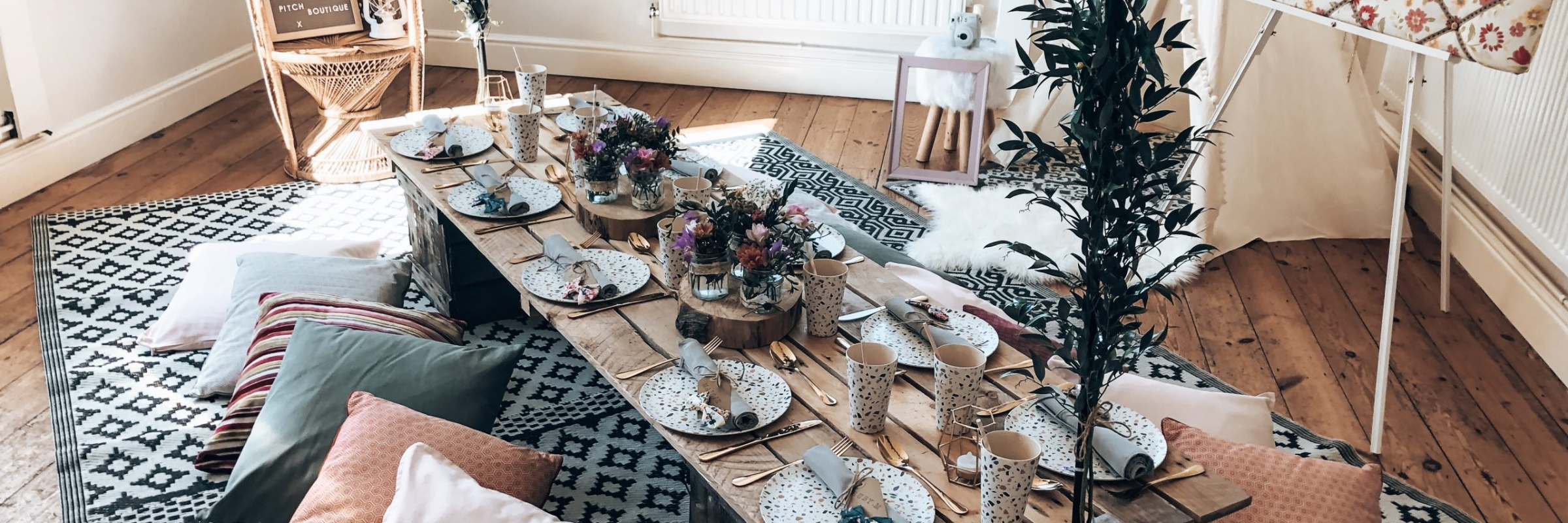 Whimsical picnic party inspiration from www.pitch-boutique.co.uk - featuring peacock chairs, English garden florals, fairy wings and flower crowns!