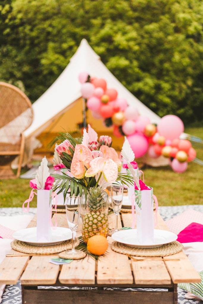 Turn your garden into a tropical island with www.pitch-boutique.co.uk - our stylish picnic party set featuring beautiful bell tents, wooden picnic tables, balloon arches, peacock chairs, flowers and grazing tables! We style events across Essex, Suffolk and London.