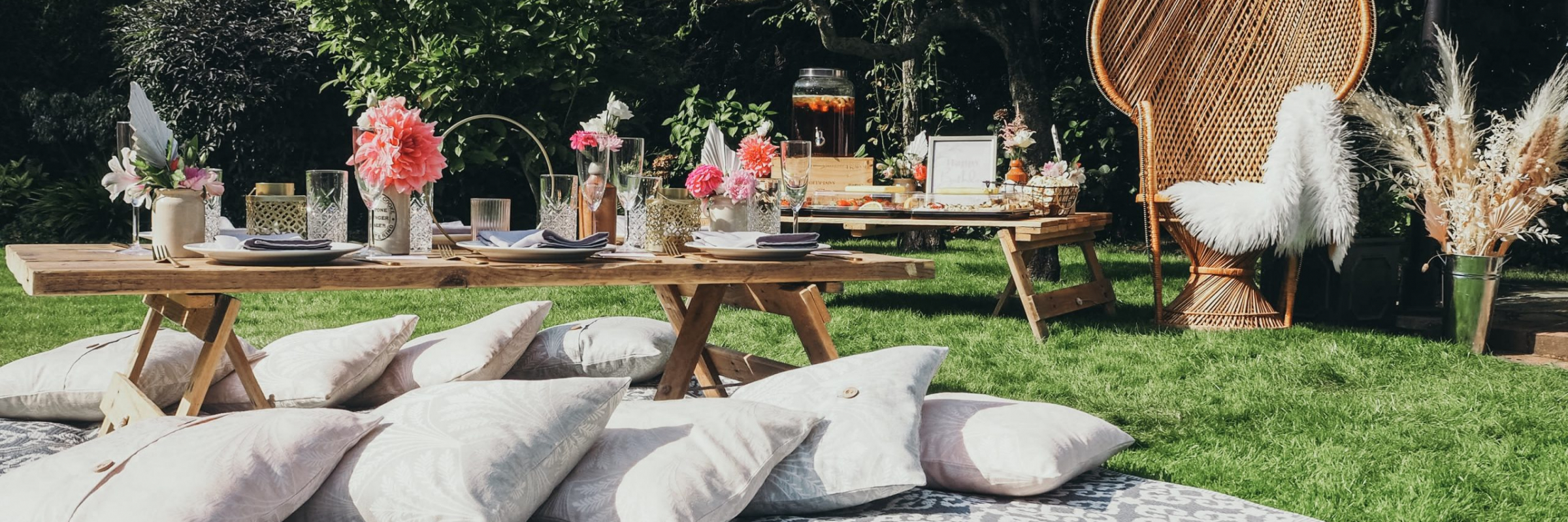 Stylish picnic party inspiration from www.pitch-boutique.co.uk - featuring reclaimed wooden tables, themed soft furnishings, peacock chairs, artisan florals and grazing tables!